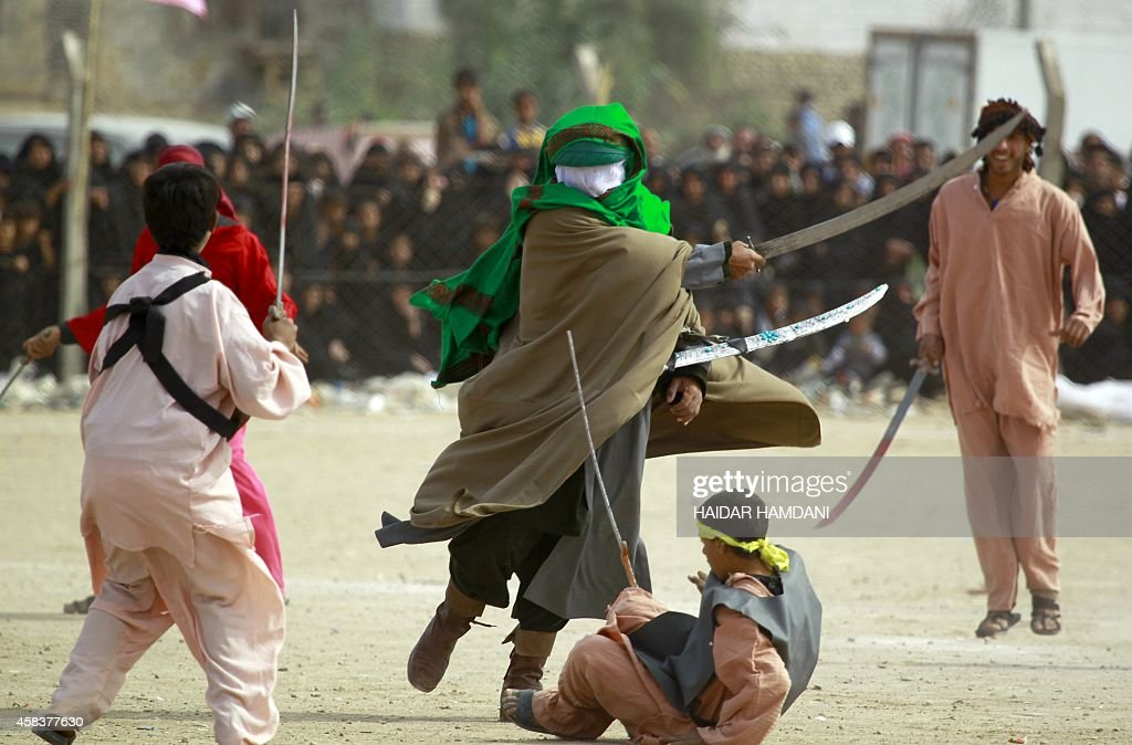 Iraqi Shiite men perform during the reenactment of the Battle of Karbala as part of the Ashura commemorations that mark the killing of Imam Hussein...