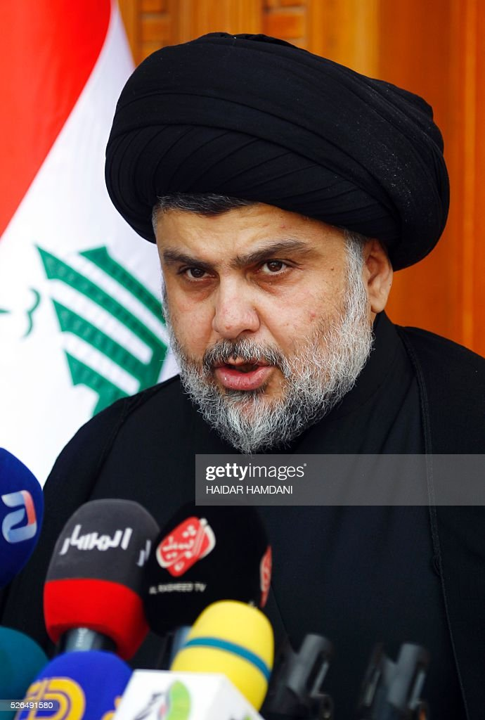 Iraqi Shiite Muslim cleric Moqtada al-Sadr speaks during a press conference in the holy Shiite city of Najaf on April 30, 2016. Sadr condemned the political deadlock, but did not order supporters to enter the Green Zone. HAMDANI