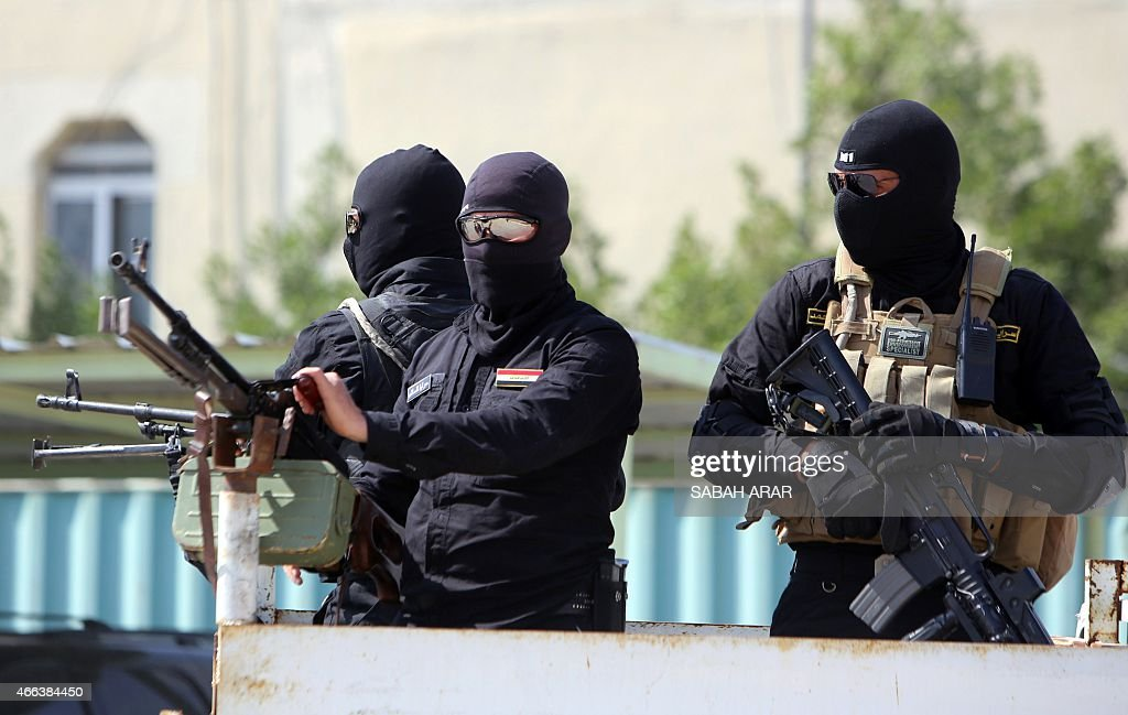 Iraqi Shiite Muslim fighters from the Saraya alSalam a group formed by Iraqi Shiite Muslim cleric Moqtada alSadr are transported on the back of a...