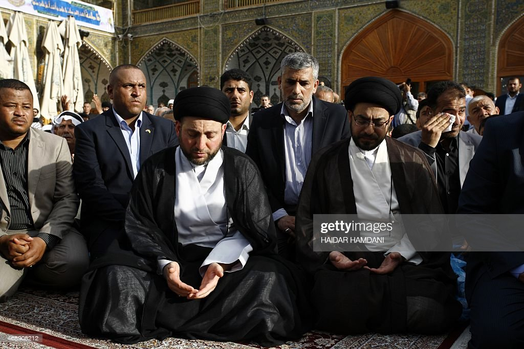 Iraqi Shiite Muslim leader <a gi-track='captionPersonalityLinkClicked' href=/galleries/search?phrase=Ammar+al-Hakim&family=editorial&specificpeople=881718 ng-click='$event.stopPropagation()'>Ammar al-Hakim</a> (C-L) prays during the funeral of Shiite Muslim cleric sheikh Mohammed Bahr al-Ulloum, former President of Iraq's interim governing council, in Iraq's central city of Najaf on April 8, 2015. AFP PHOTO / HAIDAR HAMDANI
