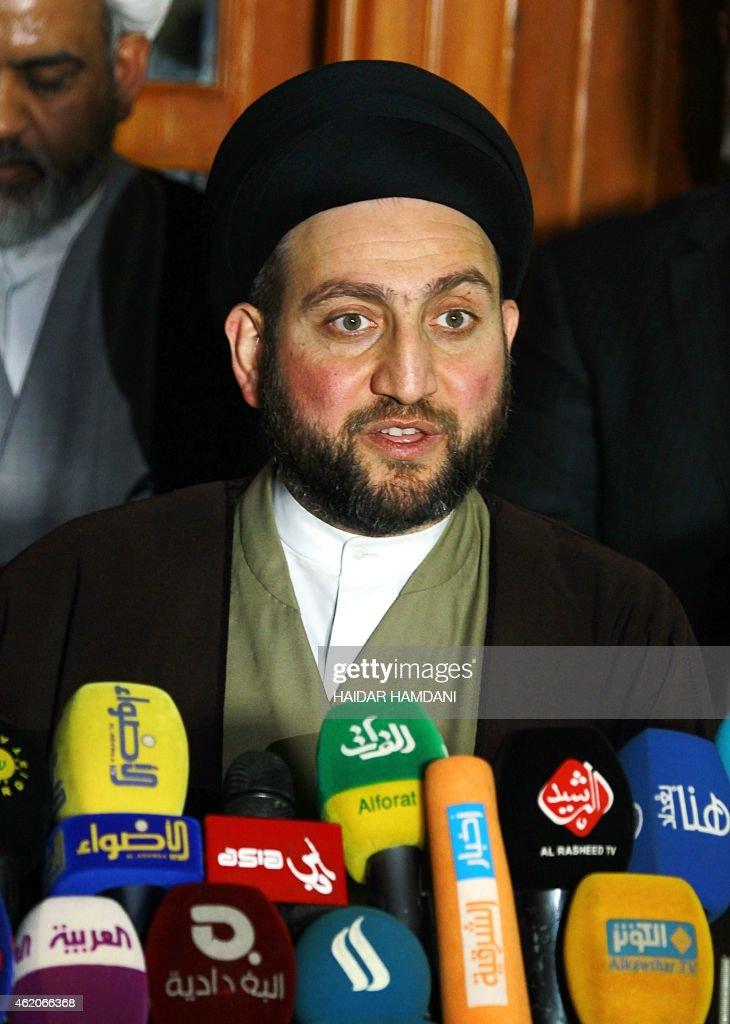 Iraqi Shiite Muslim leader <a gi-track='captionPersonalityLinkClicked' href=/galleries/search?phrase=Ammar+al-Hakim&family=editorial&specificpeople=881718 ng-click='$event.stopPropagation()'>Ammar al-Hakim</a> speaks during a meeting held at his house in the southern Shiite city of Najaf on January 23, 2015 with Iraqi Shiite cleric Moqtada al-Sadr to discuss economic and security issues. Al-Sadr expressed his hopes for a unity government and encouraged the efforts of Iraqi Prime Minister Haider al-Abadi in avoiding previously made mistakes. AFP PHOTO/ HAIDAR HAMDANI