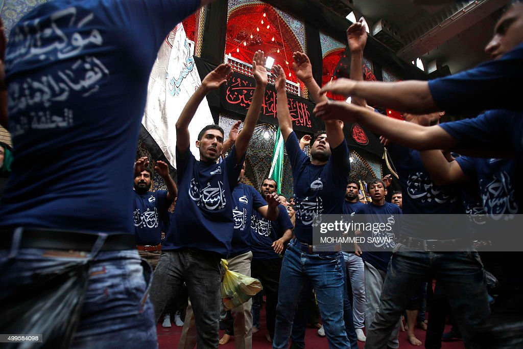 TOPSHOT Iraqi Shiite Muslim pilgrims gather at the Imam Abbas shrine on December 2 in the central Iraqi city of Karbala 120 kms south of the capital...