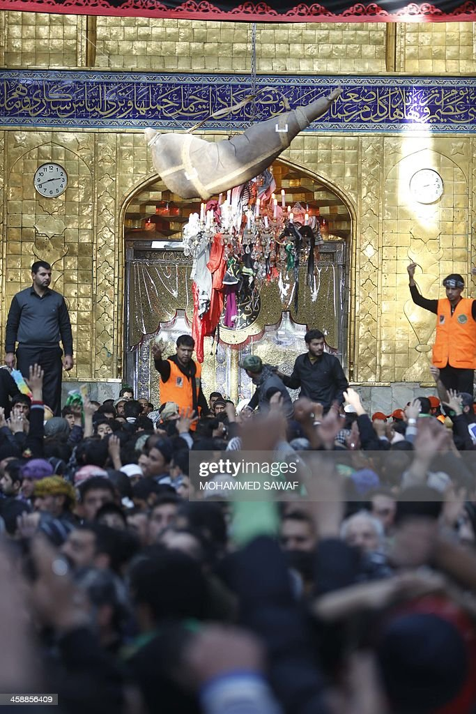 Iraqi Shiite Muslim pilgrims gather in the Shrine of Imam Abbas in the central Iraqi city of Karbala on December 22 as they take part in the Arbaeen...