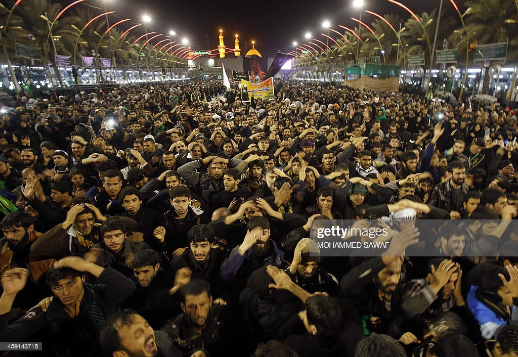 Iraqi Shiite Muslim pilgrims gather in the Shrine of Imam Abbas in the central Iraqi city of Karbala on December 23 as they take part in the Arbaeen...