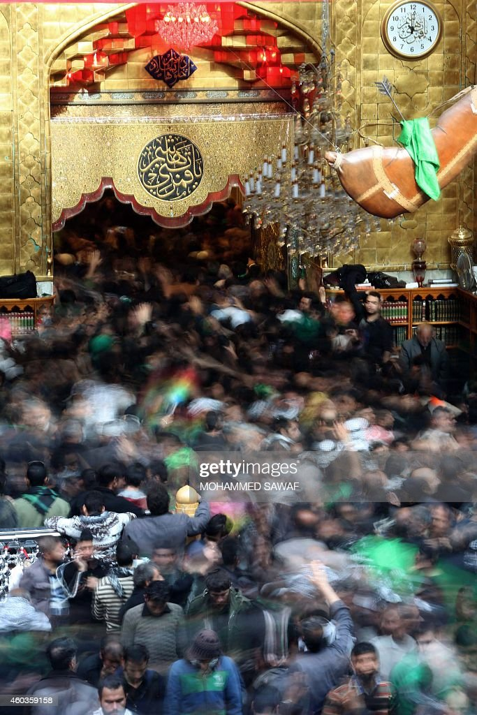 Iraqi Shiite Muslim pilgrims take part in friday prayers at the shrine of Imam Abbas in Karbala 50 miles south of Baghdad on December 12 ahead of the...