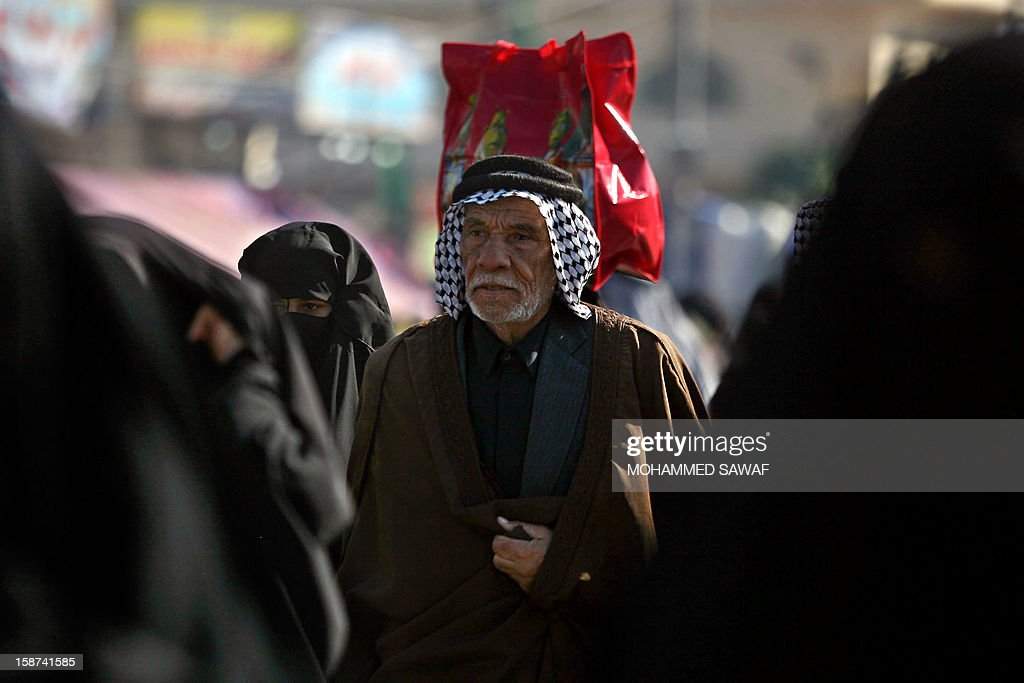 Iraqi Shiite Muslim pilgrims walk on December 27, 2012 along the main highway linking the Iraqi capital to the central shrine city of Karbala where they will mark later this week the Arbaeen religious festival which is the 40th day after Ashura commemorating the killing of Prophet Mohammed's grandson, Imam Hussein in the seventh century.