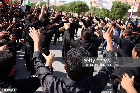 Iraqi Shiite Muslim worshipers beat their chests during a ceremony marking Ashura which commemorates the seventh century slaying of Imam Hussein the...