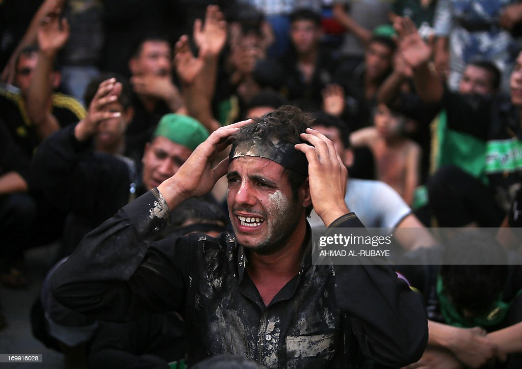 Iraqi Shiite Muslim worshipers mourn during a ritual at the shrine of Imam Musa al-Kadhim, to mark the anniversary of the death of the religious figure, in Baghdad's northern district of Kadhimiya, on June 4, 2013. Pilgrims are converging on the Imam's shrine to mark the death of the seventh Imam, who was imprisoned for four years and then poisoned by the then ruler Harun al-Rashid in 795.