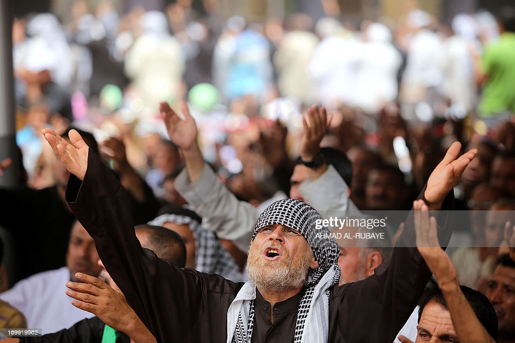 Iraqi Shiite Muslim worshipers mourn during a ritual at the shrine of Imam Musa al-Kadhim, to mark the anniversary of the death of the religious figure, in Baghdad's northern district of Kadhimiya, on June 4, 2013. Pilgrims are converging on the Imam's shrine to mark the death of the seventh Imam, who was imprisoned for four years and then poisoned by the then ruler Harun al-Rashid in 795. AFP PHOTO/AHMAD AL-RUBAYE