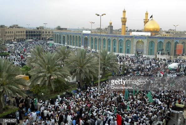 Iraqi Shiite Muslims gather in front of the Imam Hussein mosque April 21 in Karbala Iraq Millions of Shia Muslims have flocked to the holy city of...