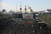 Iraqi Shiite Muslims gather outside the shrine of Imam Hussein one of Shiite Islam's most revered figures during the Ashura commemorations that mark...