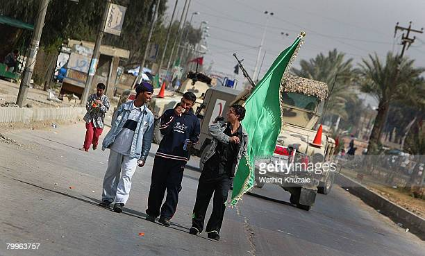 Iraqi Shiite pilgrims march to the holy Shiite city of Karbala on February 24 2008 in Baghdad Iraq Hundreds of Iraqi Shiites began their annual...