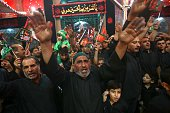 Iraqi Shiite pilgrims take part in a mourning event to commemorate Ashura which marks the seventh century slaying of Imam Hussein the grandson of...