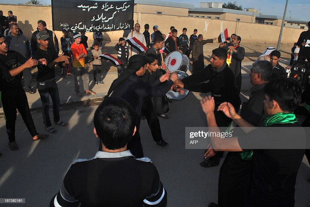 Iraqi Shiite take part in march to mark Ashura in the Iraqi town of Baghdadi, in the Anbar province, on November 30, 2012. The march saw the participation of Sunni Muslim clerics from the province, which was long associated with Islamic fundementalist groups.