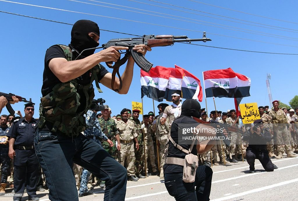 Iraqi Shiite volunteers who have joined government forces to fight Sunni jihadists from the Islamic State take part in a training session near the...