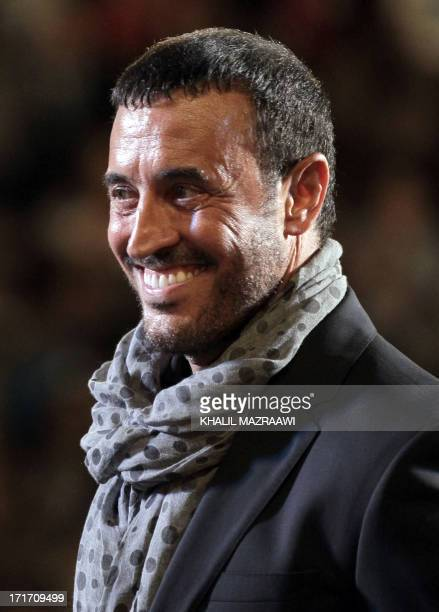 Iraqi singer Kazem alSaher performs on stage during a concert at the Jarash Festival of Culture and Arts on June 27 2013 at the South Theater of...