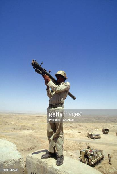Iraqi soldier holding RPG7 russian antitank weapon in Zubeidat area the day of cease fire on July 19 1988 in Iraq