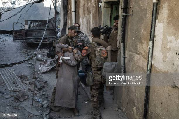 Iraqi soldiers detain a man they found in alNuri mosque complex on June 29 in Mosul Iraq The Iraqi Army Special Operations Forces and...