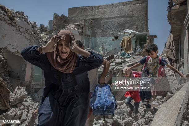Iraqi soldiers escort civilians emerging from their homes near alNuri mosque complex on June 29 in Mosul Iraq The Iraqi Army Special Operations...