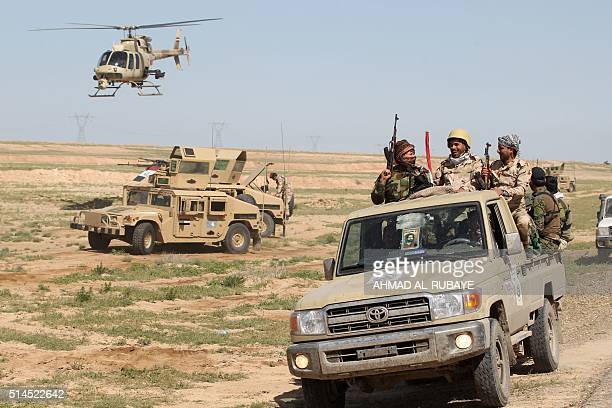 Iraqi soldiers gather at the front line in alAnbar desert 50 kms north east of Haditha where the country's forces are fighting the Islamic State...