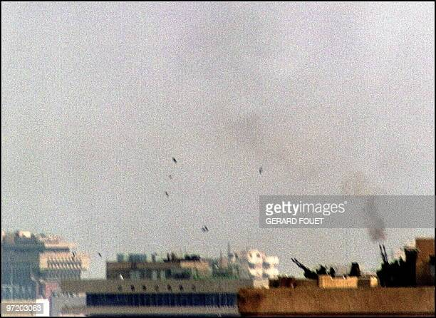 Iraqi soldiers man early 17 January 1991 an antiaircraft battery on the roof of a building in downtown Baghdad during an allied air raid Iraq's...