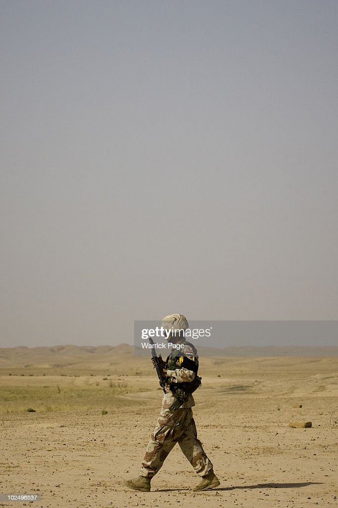 Iraqi soldiers patrol through a village during a clearance operation on June 12 2010 in Ali Juma Diyala Province Iraq Iraq faces multiple challenges...