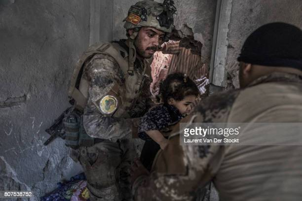 Iraqi soldiers rescue children from a room in alNuri mosque complex on June 29 in Mosul Iraq The Iraqi Army Special Operations Forces and...