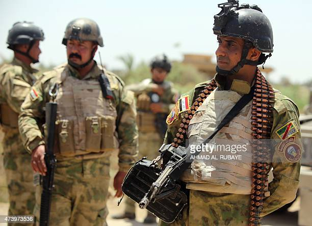 Iraqi soldiers stand in the Garma district of Anbar province west of the Iraqi capital Baghdad on May 19 2015 as clashes continue with Islamic State...