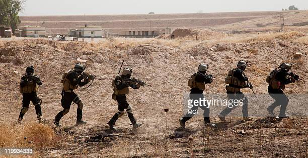 Iraqi Special Forces demonstrate their capabilities in a choreographed demonstration at Contingency Operating Site Marez As the US military prepares...