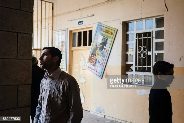 TOPSHOT Iraqi students examine the damage at their school in Mosul's alZuhur neighbourhood on January 23 while scores of schools resumed their...