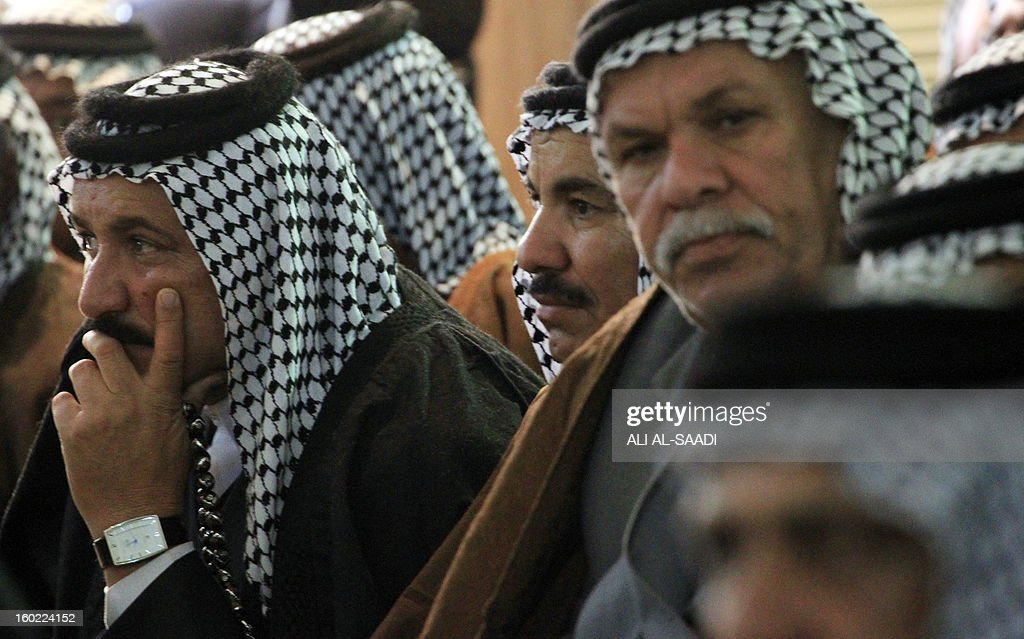 Iraqi Sunni and Shiite Muslim clan leaders attend a meeting in Baghdad on January 28, 2013 in an attempt to voice protestor demands and halt the escalation of demonstrations in Sunni areas. Protests across Sunni-majority areas in Iraq have raged in recent weeks, hardening opposition against Shiite Prime Minister Nuri al-Maliki amid a political crisis ahead of provincial elections due in April. AFP PHOTO / ALI AL-SAADI