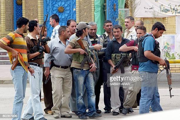 Iraqi Sunni antiQaeda Awakening fighters escort a tribal leader into Abu Hanifa mosque in Baghdad's ALAdhamiyah district on March 18 2008 Sunni...