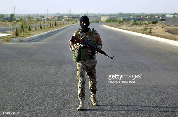 Iraqi Sunni men presented as former jihadists fighting alongside the Islamic State group who defected to join Iraq government forces take position in...