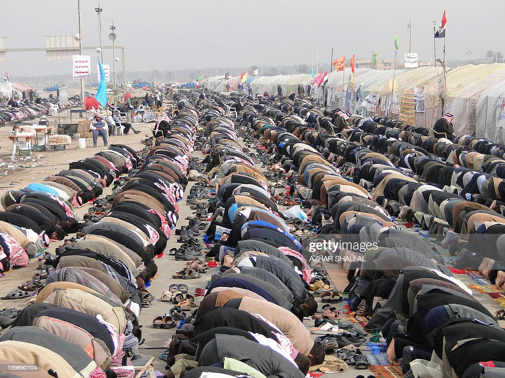Iraqi Sunni Muslims perform the weekly Friday prayer before taking to the streets in an anti-government protest in the western Iraqi city of Ramadi on January 18, 2013. Thousands of Sunni Muslims took to the streets of the capital Baghdad and other parts of Iraq on to decry the alleged targeting of their minority, in rallies hardening opposition to the country's Shiite leader. AFP PHOTO/AZHAR SHALLAL