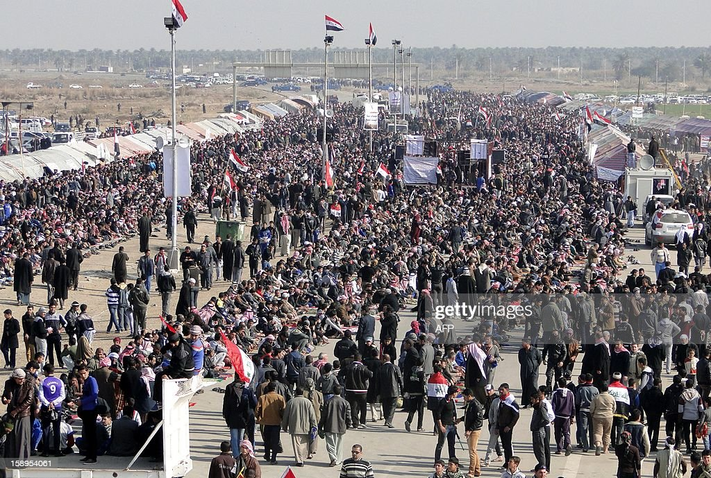 Iraqi Sunni protestors gather on the main highway to Syria and Jordan near Ramadi, Anbar's provincial capital west of Baghdad, on Januray 4, 2013, during a demonstration against Prime Minister Nuri al-Maliki's and calling for the release of prisoners they allege were arrested on sectarian grounds by Iraq's Shiite-led authorities. Protesters have been demonstrating in Ramadi since December 23. AFP PHOTO /AZHAR SHALLAL