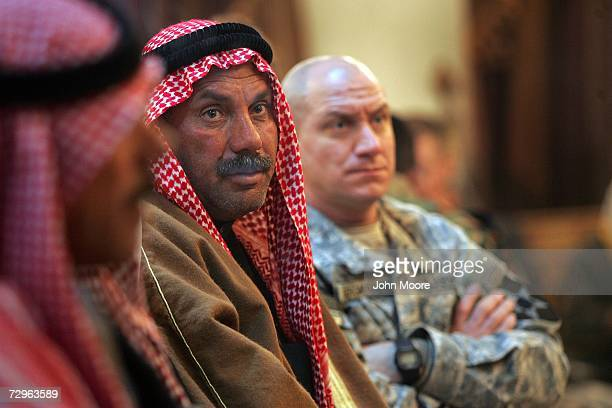 Iraqi Sunni tribal delegates and American soldiers attend the Ramadi Reconstruction Conference organized between the US military and tribal leaders...