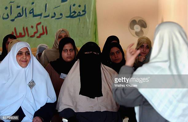 Iraqi Sunni women attend a religious lesson at alZahra Religious Association November 27 2004 in Baghdad Iraq The number of religious bodies and...