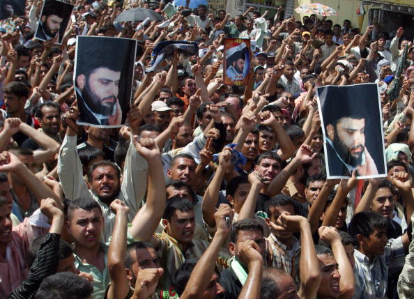 http://media.gettyimages.com/photos/iraqi-supporters-of-radical-shiite-cleric-moqtada-alsadr-hold-his-picture-id53464374?k=6&m=53464374&s=594x594&w=0&h=9EOL11u3jrrqCnXsFCk6NIY2uwKah6lH7casG1IClj0=