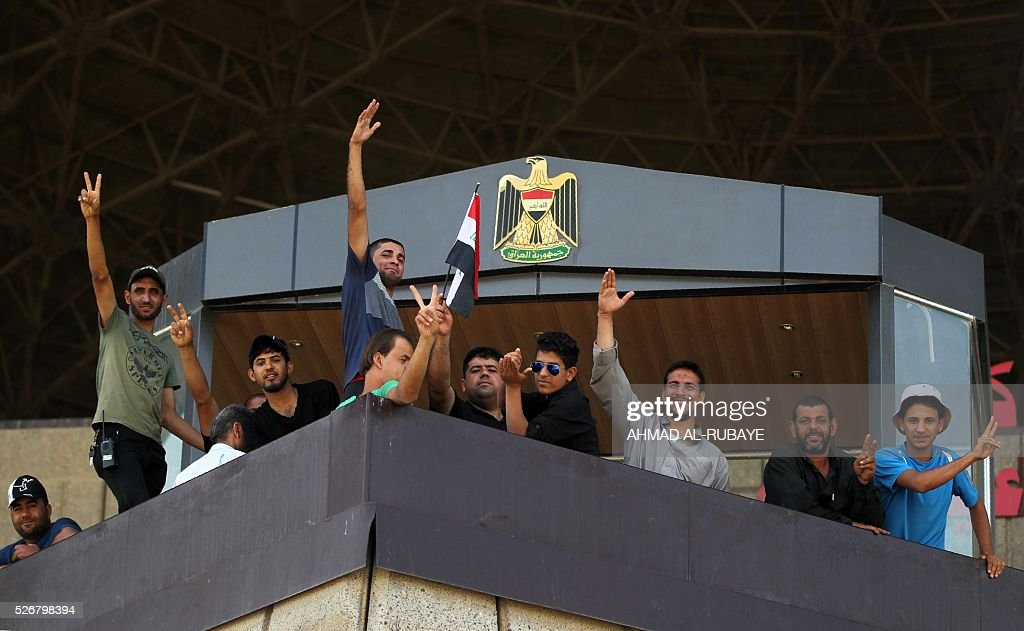 Iraqi supporters of Shiite cleric Moqtada al-Sadr gather in the parade grounds outside the parliament on May 1, 2016, the day after breaking into Baghdad's heavily fortified 'Green Zone' after lawmakers again failed to approve new ministers. Thousands of wide-eyed Iraqis marvelled at the fountains, flowers and perfect lawns in the capital's Green Zone, a day after protesters breached the walls of the fortified area. The visitors were mostly protesters who broke in but also included Baghdadis taking the opportunity to see an area that was off-limits for so many years that it acquired almost mythical status in the psyche of ordinary citizens RUBAYE