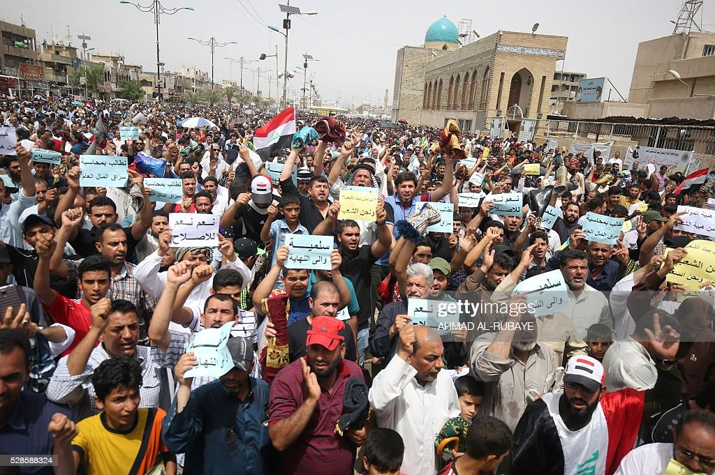 Iraqi supporters of Shiite cleric Moqtada al-Sadr shout slogans during a protest against corruption in Baghdad's Sadr City on May 6, 2016, a week after protesters broke into the fortified Green Zone and stormed the parliament. Thousands of mostly Sadrist protesters pulled down blast walls around the Green Zone and stormed the chamber on March 30 after MPs again failed to agree on reforms. RUBAYE