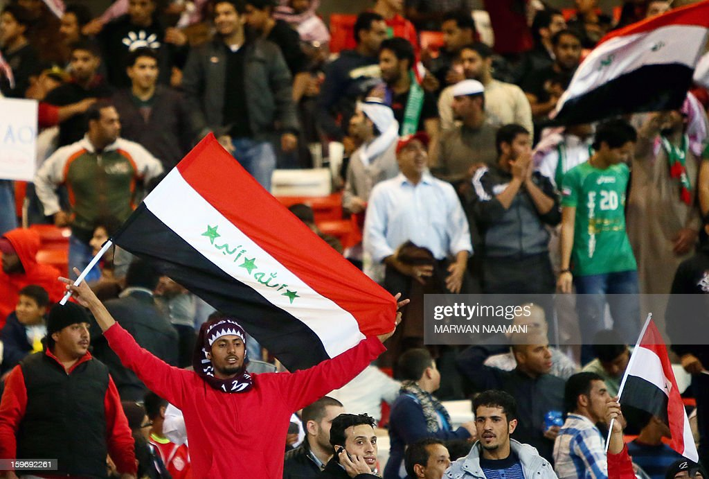 Iraqi supporters wave flags prior the start of the Gulf Cup's final football match between United Arab Emirates (UAE) and Iraq on January 18, 2013 in Manama . AFP PHOTO/MARWAN NAAMANI
