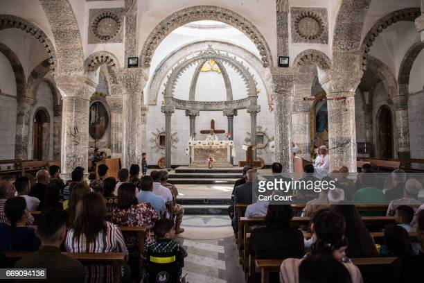 Iraqi Syriac Christian priest Charbel Aesso leads an easter service at Saint John's Church in the nearly deserted predominantly Christian Iraqi town...