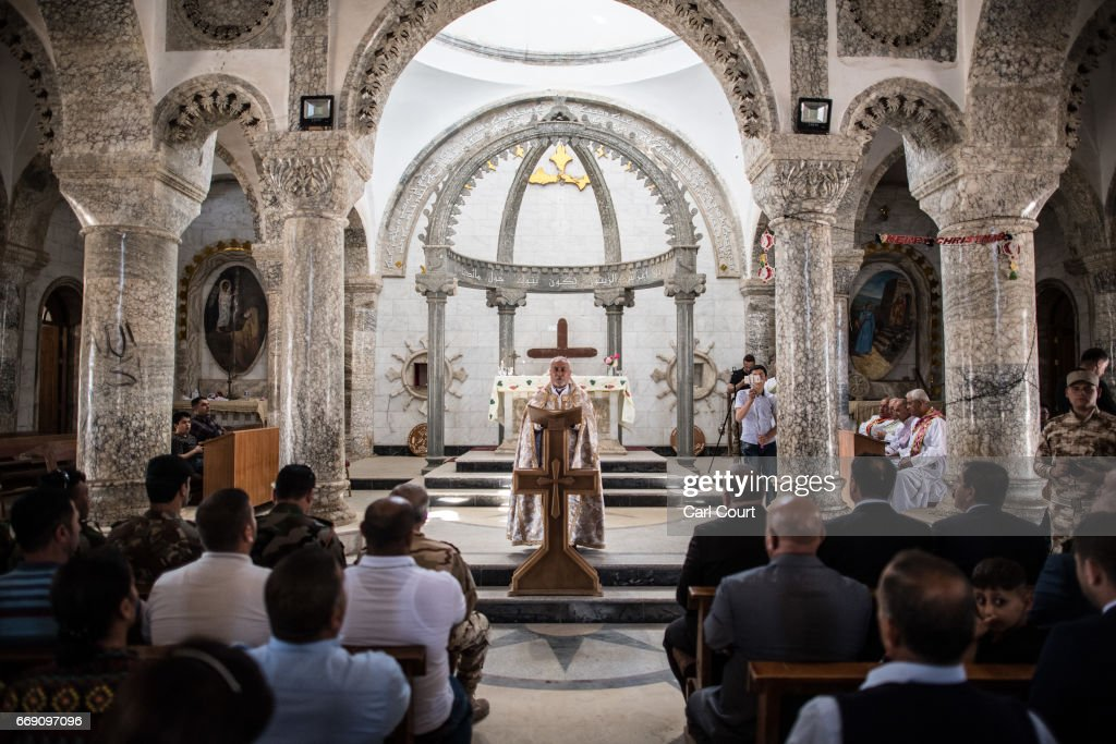 Iraqi Syriac Christian priest Charbel Aesso leads an easter service at Saint John's Church (Mar Yohanna) in the nearly deserted predominantly Christian Iraqi town of Qaraqosh on April 16, 2017 near Mosul, Iraq. Qaraqosh was retaken by Iraqi forces in 2016 during the offensive to capture the nearby city of Mosul from Islamic State but it remains almost completely deserted.
