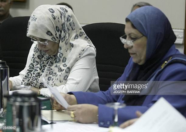 Iraqi teacher and grassroots activist Shangul Shapuk and medical doctor Rajiha Habib Kurzai attend a meeting of Iraq's Governing Council in Baghdad...