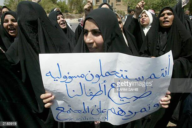 Iraqi teachers and professors demonstrate against what they say is their unfair dismissal by USled occupation forces 20 July 2003 in Baghdad The...