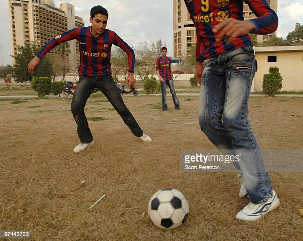Iraqi teenage boys play soccer in a park along the Tigris River near the Palestine Hotel and Sheraton Ishtar hotel on February 3 2010 in Baghdad Iraq...