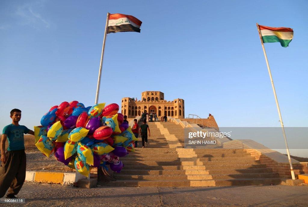 Iraqi tourists visit the Sherwana Citadel in the Kurdish city of Kalar 126 kms south of Sulaimaniya on September 27 2015 AFP PHOTO / SAFIN HAMED