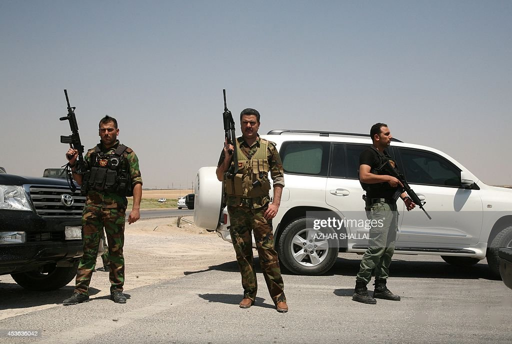 Iraqi tribesmen join government security forces on August 14 2014 to secure the main highway near Anbar's provincial capital Ramadi west of Baghdad...