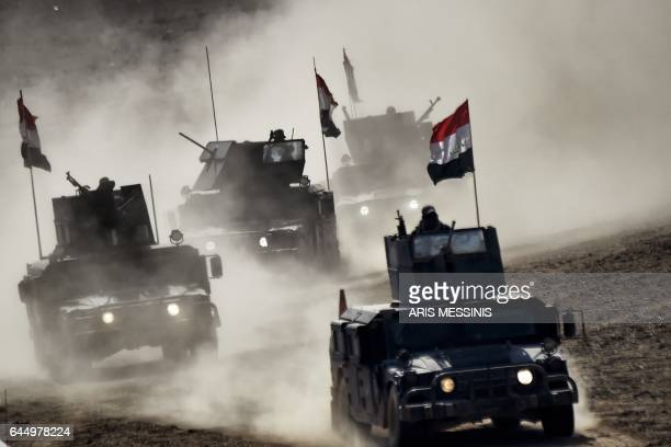 TOPSHOT Iraqi troops advance towards Mosul's on February 24 2017 during an ongoing offensive to retake the northern city from jihadists of the...