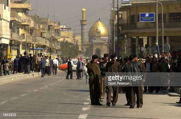Iraqi troops and ruling Baath Party officials watch over a demonstration against an Americanled war in Iraq and in favor of the regime of Saddam...